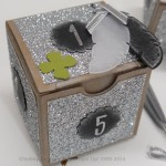 Glitzer-Geschenkverpackung als Silvester-Deko